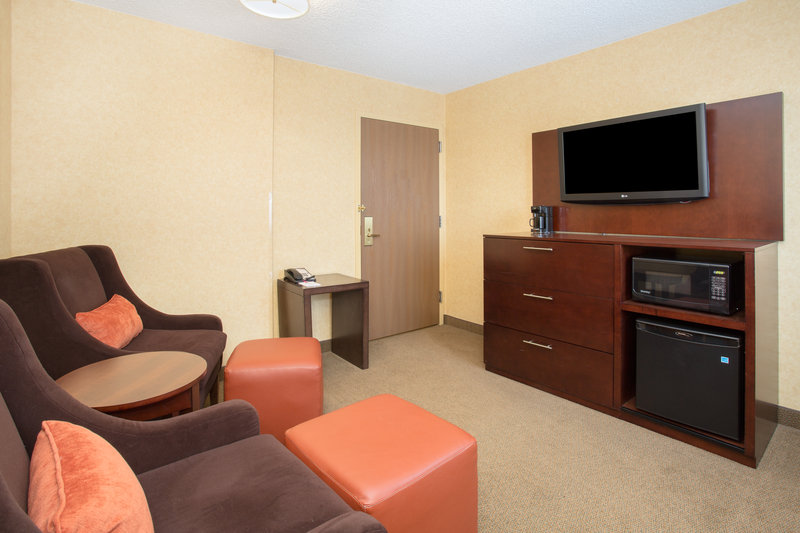 Crowne Plaza Denver Airport Convention Center-Unwind in your suite's living area while you watch a TV show.<br/>Image from Leonardo