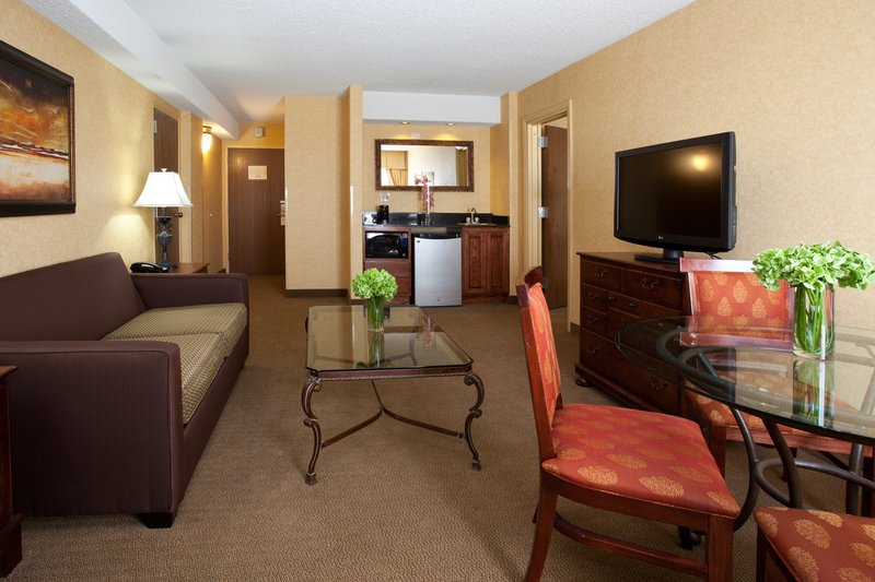 Crowne Plaza Denver Airport Convention Center-Unwind in your suite's living room while you watch a TV show<br/>Image from Leonardo