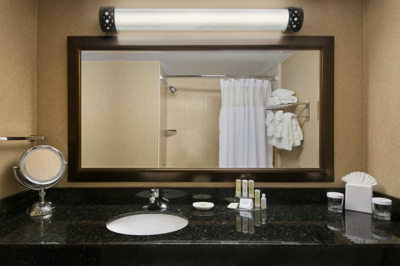 Crowne Plaza Denver Airport Convention Center-Our guest bathrooms have plenty of counter space to get ready.<br/>Image from Leonardo
