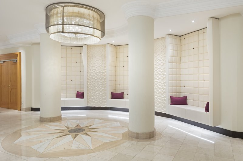 Crowne Plaza Heidelberg City Centre-Elegant white foyer with a pillar and seating areas.<br/>Image from Leonardo