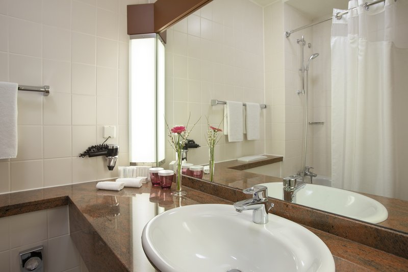 Crowne Plaza Heidelberg City Centre-An attractive bathroom with a large mirror in a king-size room.<br/>Image from Leonardo