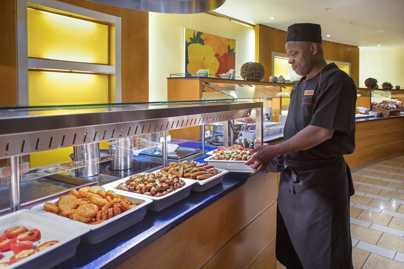 Crowne Plaza Heidelberg City Centre-Friendly staff serving hot dishes for breakfast in the restaurant.<br/>Image from Leonardo