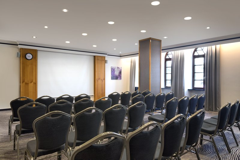 Crowne Plaza Heidelberg City Centre-Theatre-style seating in a well-equipped meeting room.<br/>Image from Leonardo