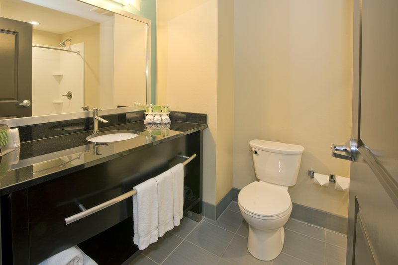 Holiday Inn Express & Suites Colorado Springs Central-Spacious guest bathroom<br/>Image from Leonardo