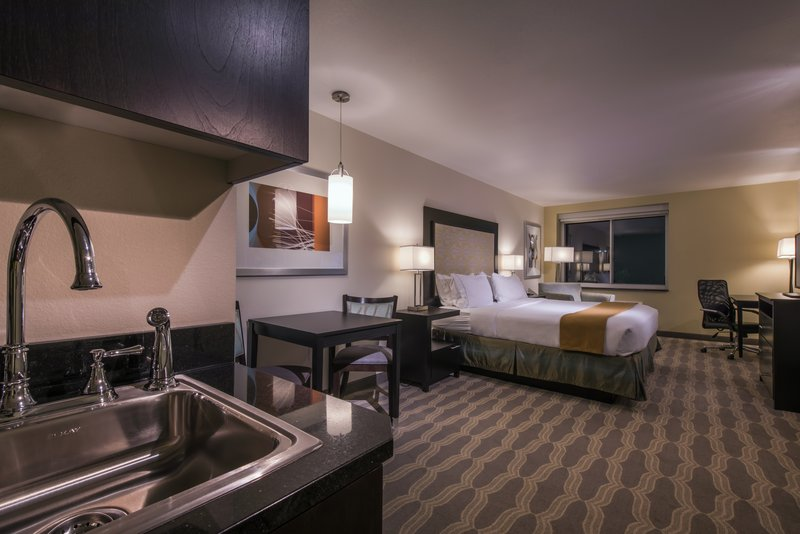 Holiday Inn Express & Suites Colorado Springs Central-King accessible room with roll-in shower and grab bars.<br/>Image from Leonardo