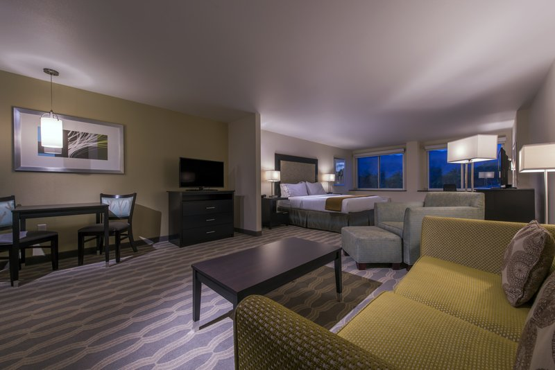 Holiday Inn Express & Suites Colorado Springs Central-King suite with separate living area and sofa bed.<br/>Image from Leonardo