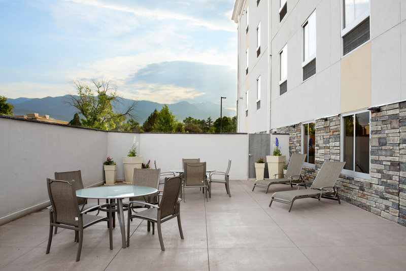 Holiday Inn Express & Suites Colorado Springs Central-Enjoy the outdoor patio with access to indoor pool<br/>Image from Leonardo