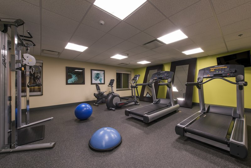 Holiday Inn Express & Suites Colorado Springs Central-24 hour fitness center with plenty of equipment!<br/>Image from Leonardo