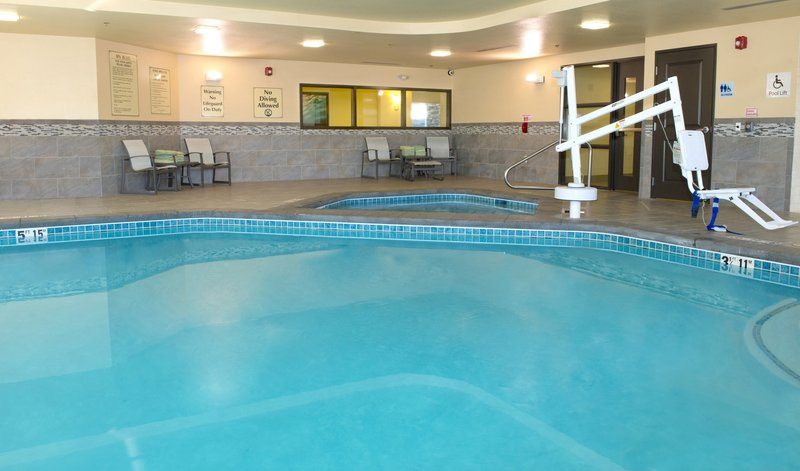 Holiday Inn Express & Suites Colorado Springs Central-Our Pool area features dual showers and relaxing lounge chairs<br/>Image from Leonardo