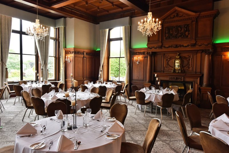Principal York-Oak room with its ornate fireplace and cut-glass chandeliers<br/>Image from Leonardo