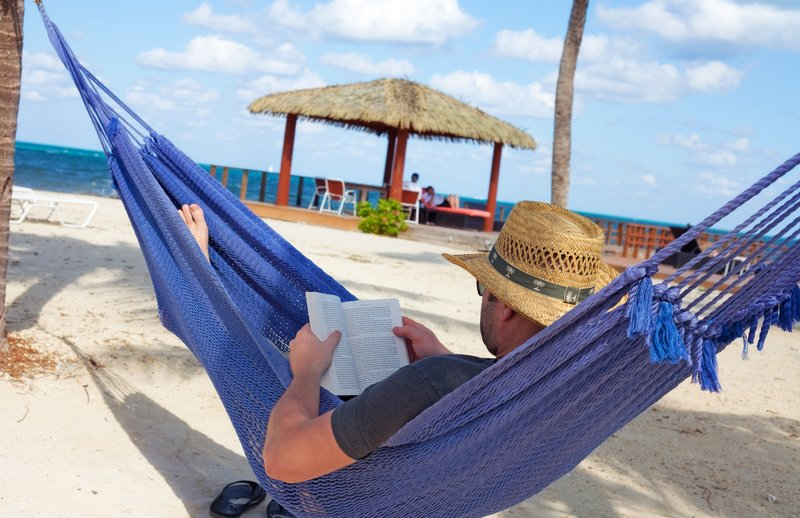 Holiday Inn Resort Grand Cayman-Relax with a book beachside at the Holiday Inn Resort<br/>Image from Leonardo