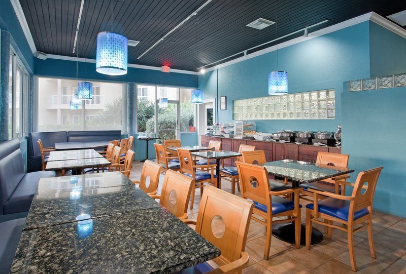 Holiday Inn Resort Grand Cayman-Restaurant, indoor, air conditioned, group meals, buffets avail<br/>Image from Leonardo