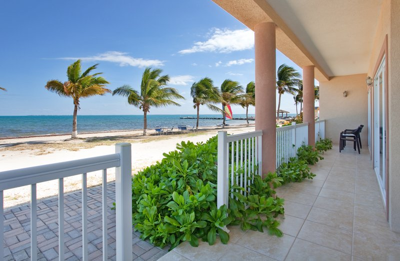 Holiday Inn Resort Grand Cayman-Guest Patio at the Holiday Inn Resort Grand Cayman<br/>Image from Leonardo