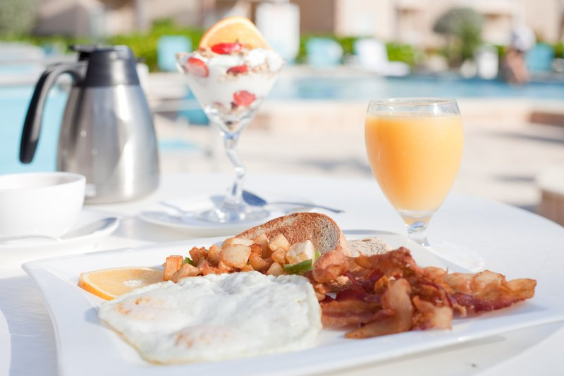 Holiday Inn Resort Grand Cayman-Enjoy your morning breakfast, poolside at the Holiday Inn Resort<br/>Image from Leonardo