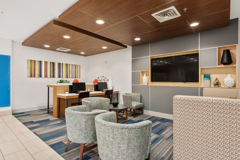 Holiday Inn Express & Suites Salt Lake City West Valley-Collaborate with colleagues in our luxurious lobby.<br/>Image from Leonardo
