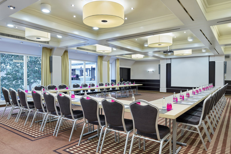 Crowne Plaza Hamburg - City Alst-A meeting room with tables and chairs set up in U-shaped format.<br/>Image from Leonardo