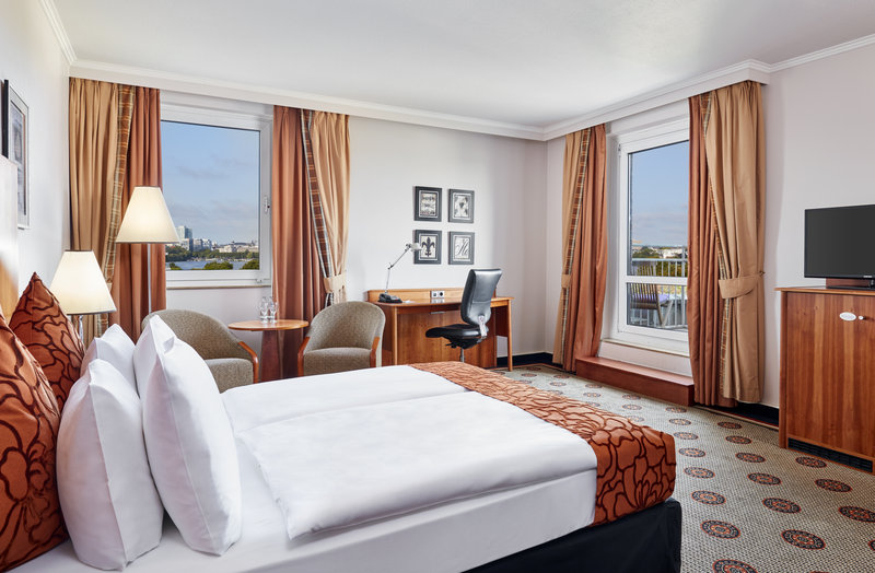 Crowne Plaza Hamburg - City Alst-Club room with a desk, armchairs, private balcony and city views.<br/>Image from Leonardo