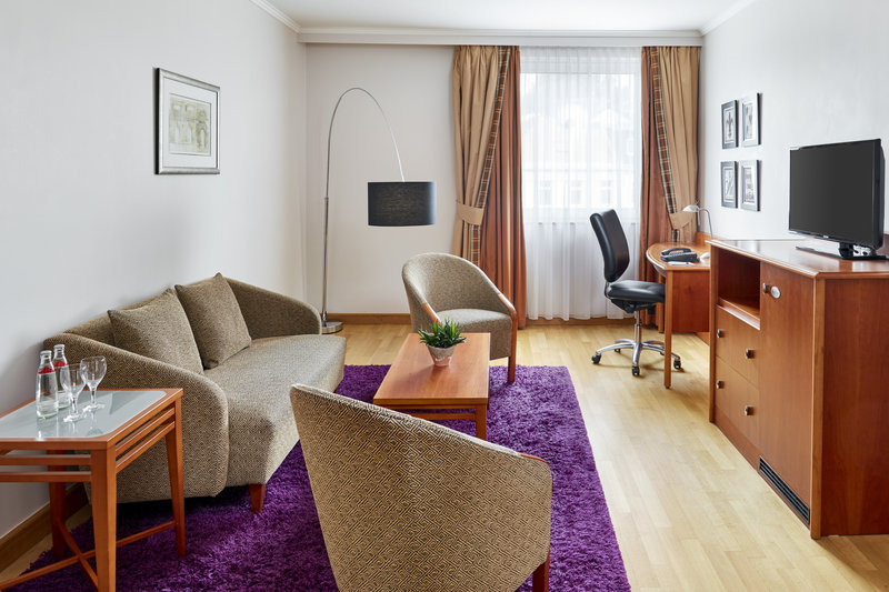 Crowne Plaza Hamburg - City Alst-Junior suite with a sofa, armchairs and a useful work desk. <br/>Image from Leonardo