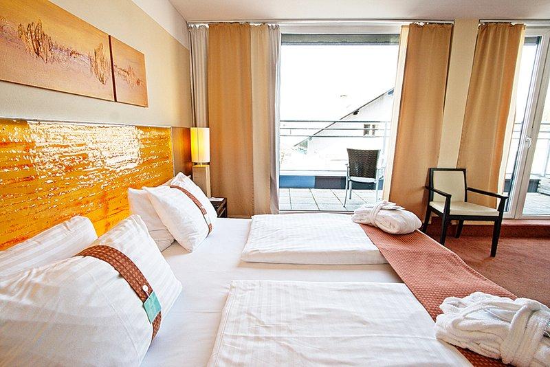 Holiday Inn Salzburg City-Superior Room with a private balcony.<br/>Image from Leonardo