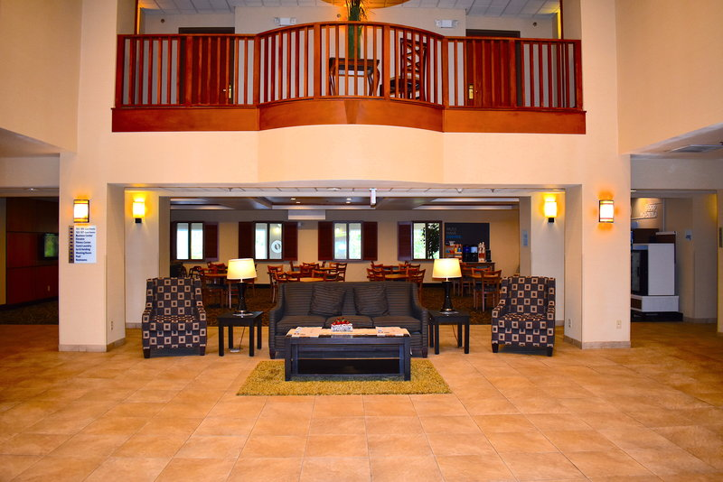 Holiday Inn Express Syracuse-Fairgrounds-Holiday Inn Express Lobby Entrance located at Exit 39 NYS Thruway.<br/>Image from Leonardo