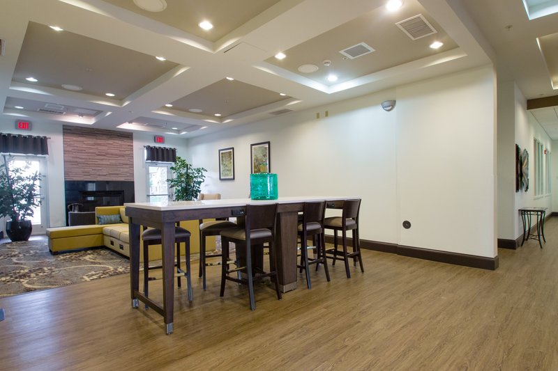 Holiday Inn Hotel & Suites Bloomington - Airport-Community tables in our lobby with charging ports<br/>Image from Leonardo