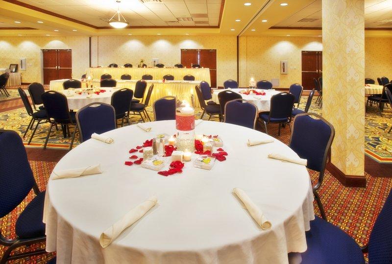 Holiday Inn Quincy East-The Holiday Inn Full Ballroom in Wedding Reception Layout.<br/>Image from Leonardo