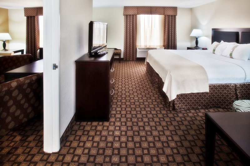 Holiday Inn Quincy East-Our King Suite with living room and separate bedroom.<br/>Image from Leonardo