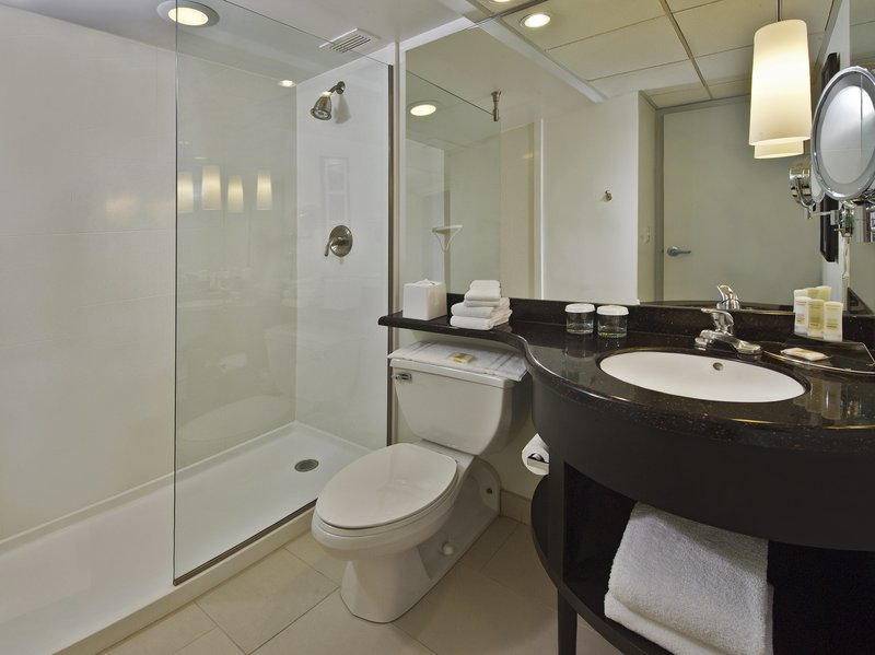 Crowne Plaza Suffern-Mahwah-Spacious, marble-finished bathroom with separate bath and shower.<br/>Image from Leonardo