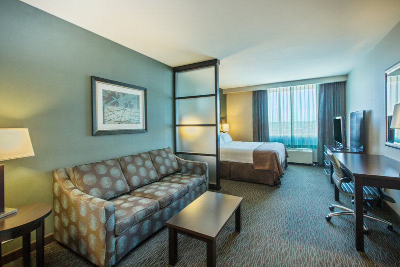 Holiday Inn Saskatoon Downtown-King Bed guest room with sleeper sofa.  Sleeps up to (4) guests<br/>Image from Leonardo