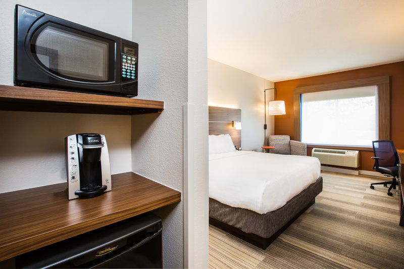 Holiday Inn Express & Suites Bellevue (Omaha Area)-Visit us during your next trip to Omaha in this comfy king bedroom<br/>Image from Leonardo