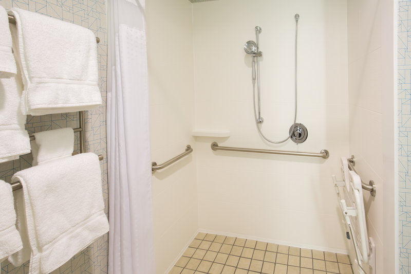 Holiday Inn Express & Suites Pahrump-ADA/Handicapped accessible Guest Bathroom with roll-in shower<br/>Image from Leonardo