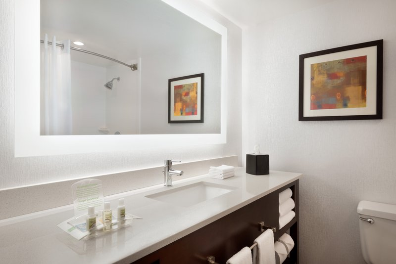 Holiday Inn Rock Island - Quad Cities-Our remodeled guest bathroom has plenty of light and counter space<br/>Image from Leonardo