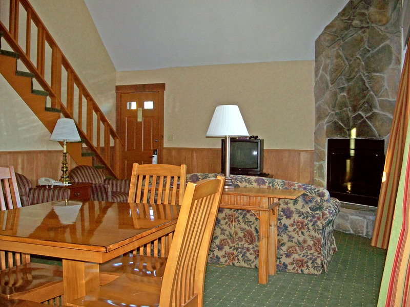 Crowne Plaza Lake Placid-Chalet Living Room with Fireplace<br/>Image from Leonardo