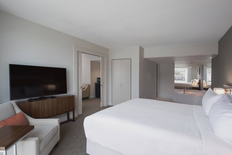 Delta Hotels by Marriott St John's Conference Centre-Whirlpool King Suite - Bedroom<br/>Image from Leonardo