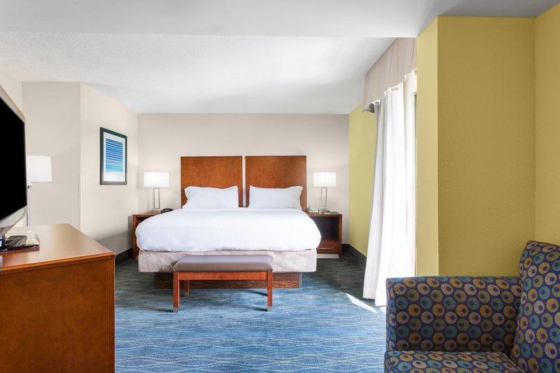 Holiday Inn Express Wilmington-The Imperial Suite features a bedroom and a separate living area.<br/>Image from Leonardo
