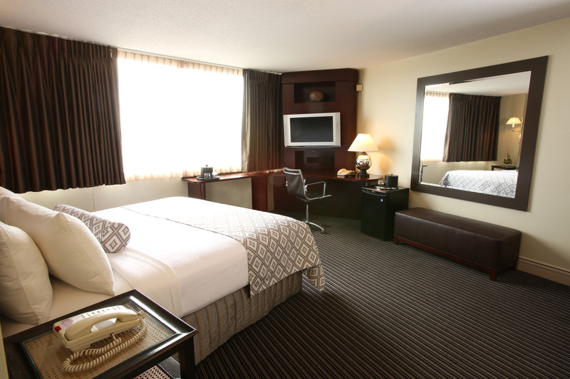 Crowne Plaza Syracuse-Our single double beds provide extra room to move around.<br/>Image from Leonardo