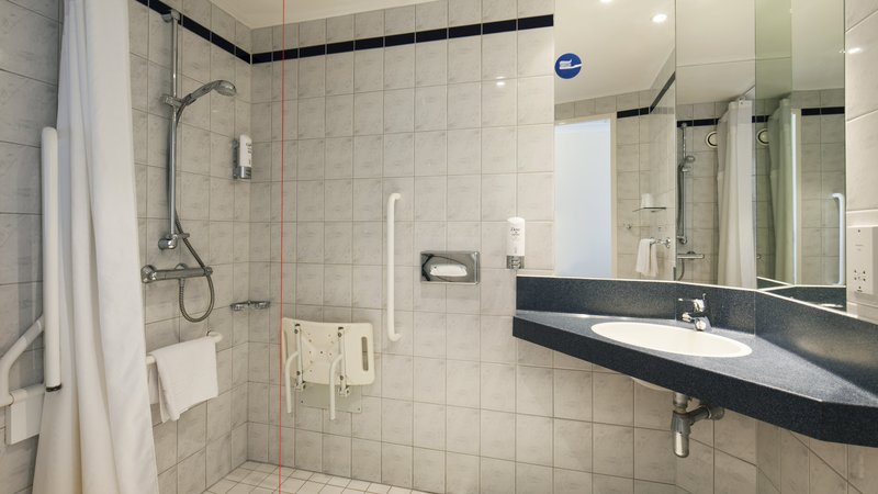 Holiday Inn Express Oxford - Kassam Stadium-Accessible shower bathroom<br/>Image from Leonardo