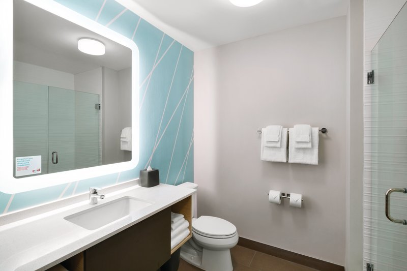 Avid Hotel Oklahoma City Airport-A bright bathroom with a large backlit mirror<br/>Image from Leonardo