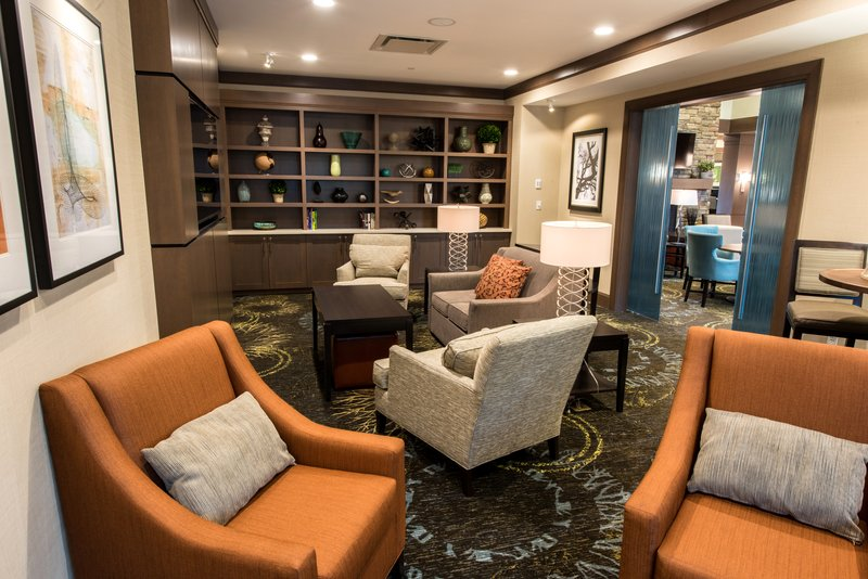 Staybridge Suites Albany Wolf Rd - Colonie Center-The Den<br/>Image from Leonardo