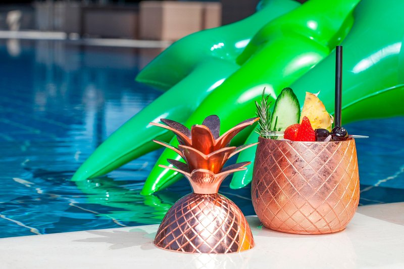 Hotel President Wilson; a Luxury Collection Hotel-Pool Bar - Pineapple Elyx Cocktail<br/>Image from Leonardo