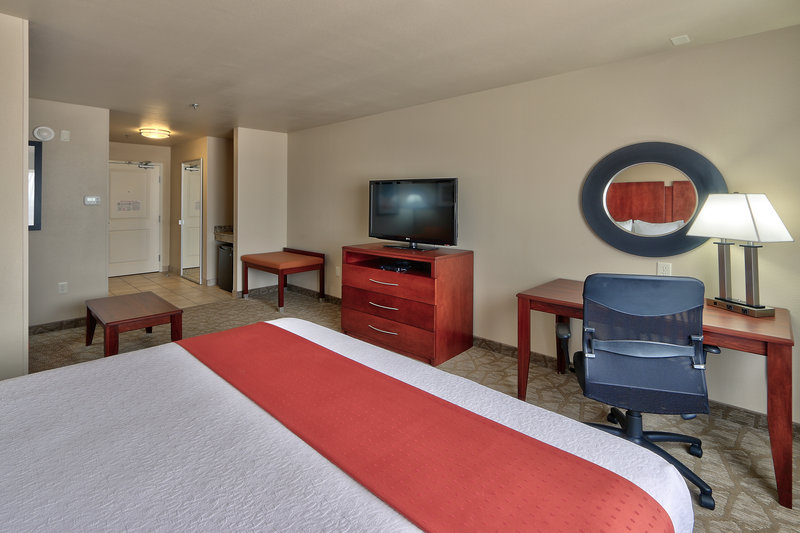 Holiday Inn Roswell-King Bed Room.  Microwave, fridge, coffee keurig, and sleeper sofa<br/>Image from Leonardo