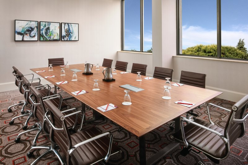 Crowne Plaza Dallas Market Center-Our executive table and comfortable chairs are ideal for meetings.<br/>Image from Leonardo