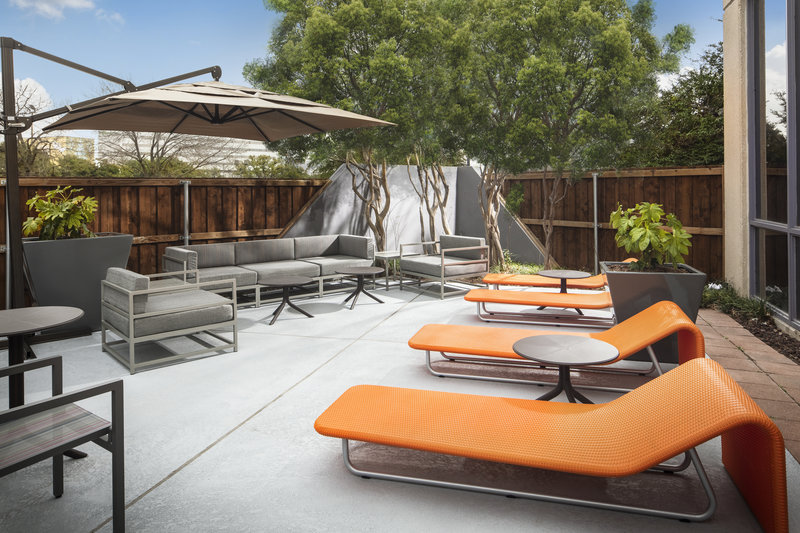 Crowne Plaza Dallas Market Center-Lounge comfortably near our swimming pool and enjoy the sunshine.<br/>Image from Leonardo