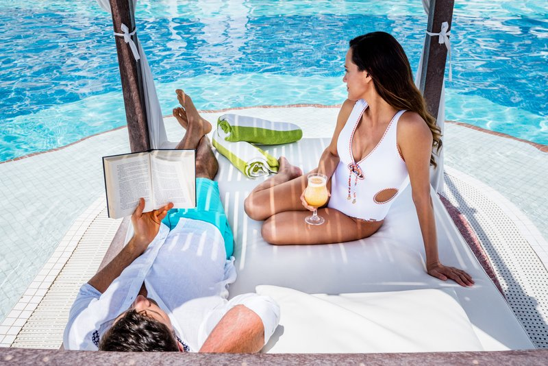 Hyatt Zilara Cancun - Couple in a Pool Cabana <br/>Image from Leonardo