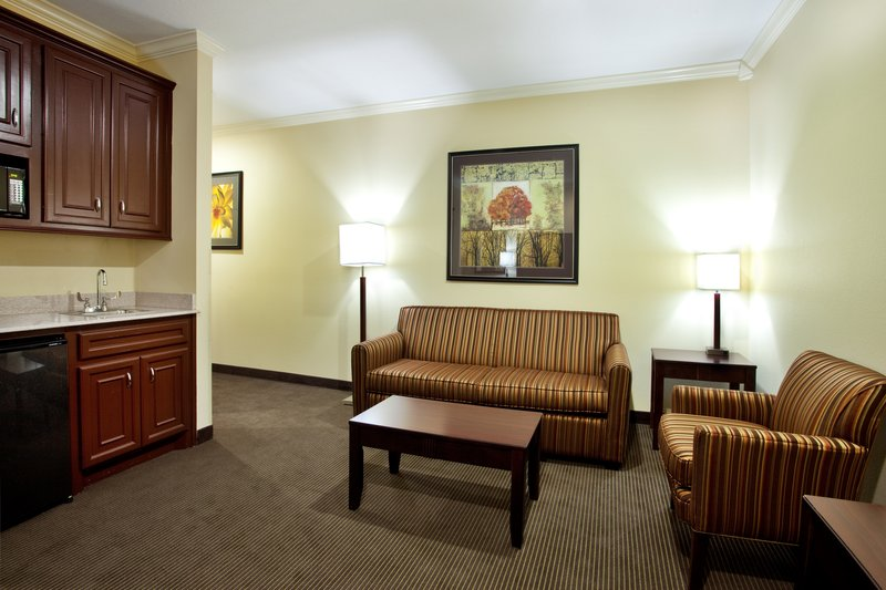 Holiday Inn Hotel & Suites Lake Charles South-King Suite - Living Room with fold-out sofa bed<br/>Image from Leonardo