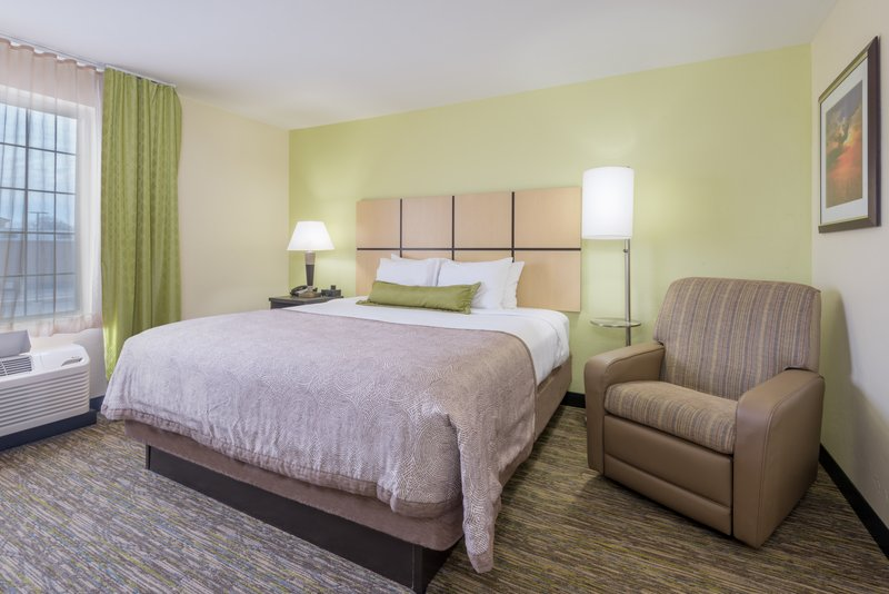Candlewood Suites Midwest City-King Studio Suite Bedroom<br/>Image from Leonardo