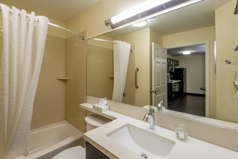 Candlewood Suites Midwest City-One Bedroom King Suite Guest Bathroom<br/>Image from Leonardo