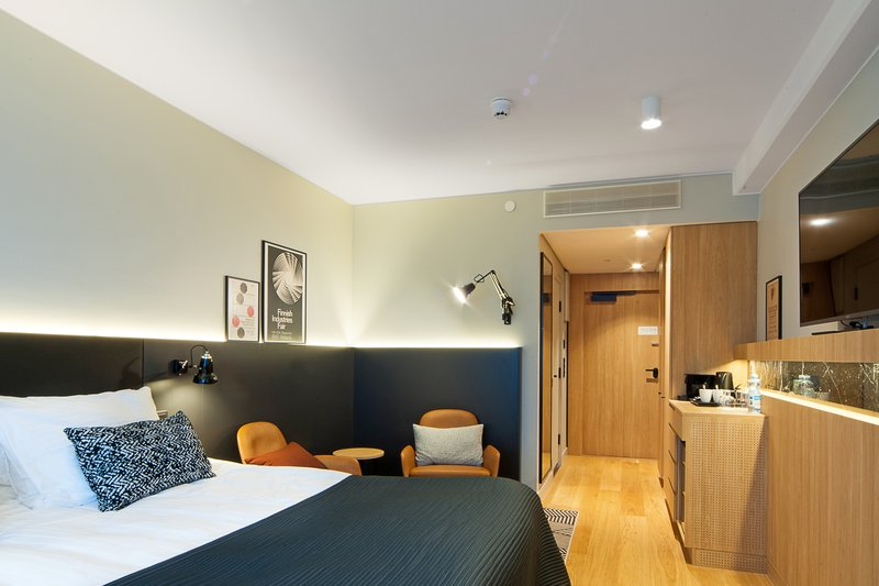 Holiday Inn Helsinki - Exhibition & Convention Centre-Our Executive room features comfortable bed and two leather chairs<br/>Image from Leonardo