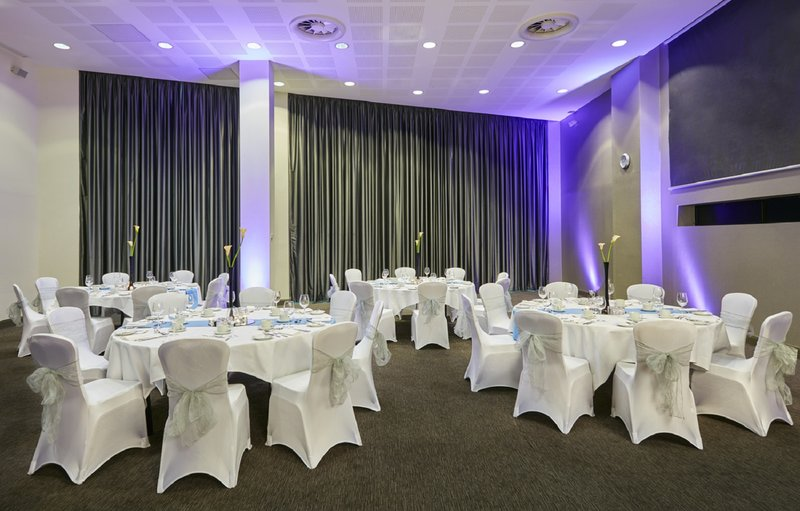 Crowne Plaza Manchester City Centre-Smithfield Suite One in banquet layout<br/>Image from Leonardo