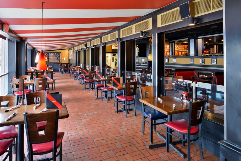 Holiday Inn Express & Suites Buffalo Downtown-Seating area in TGI Friday's<br/>Image from Leonardo
